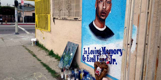 Dec. 30, 2014: a street side memorial with a painted portrait of Ezell Ford near where he was shot when police confronted him on Aug. 11, 2014, is shown on a street near his home in South Los Angeles.
