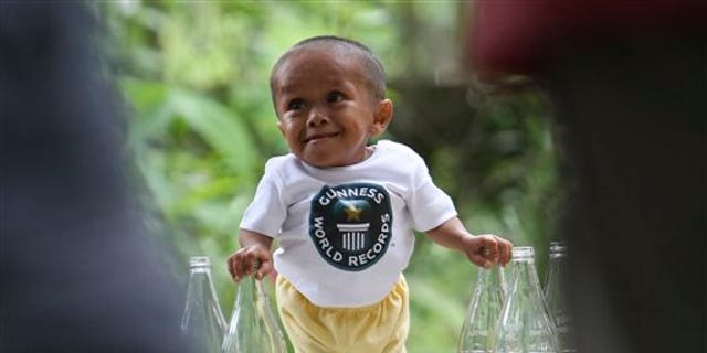 June 11: Junrey Balawing poses for a Guinness World Records-hired photographer after a series of measurement conducted by its representative at Sindangan Health Center, Sindangan township, Zamboanga Del Norte province in Southern Philippines on the eve of his 18th birthday