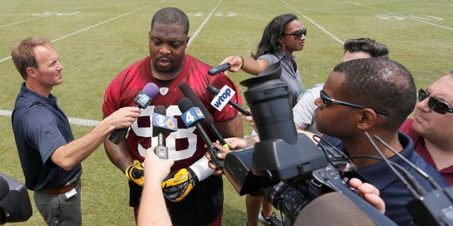 May 26, 2015; Ashbury, VA, USA; Washington Redskins nose tackle Terrance Knighton (98) speaks with the media after the Redskins OTA at Redskins Park. Mandatory Credit: Geoff Burke-USA TODAY Sports