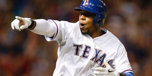 Jun 12, 2015; Arlington, TX, USA; Texas Rangers shortstop Elvis Andrus (1) points to the dugout after hitting a two run home run in the seventh inning against the Minnesota Twins at Globe Life Park in Arlington. Texas won 6-2. Mandatory Credit: Tim Heitman-USA TODAY Sports