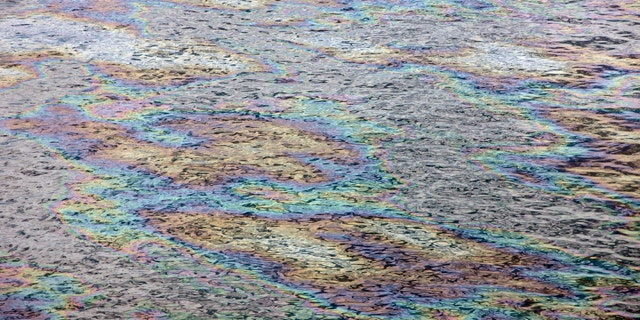 June 13: The surface of the Gulf of Mexico glistens with color as light reflects off the oil sheen at the site of the Deepwater Horizon oil spill in the Gulf of Mexico.