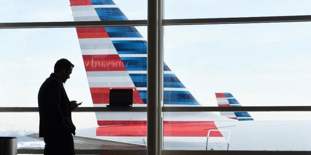 Emergency personnel in Minnesota were under fire Tuesday for their handling of a woman who was unresponsive in a bathroom on board an American Airlines flight