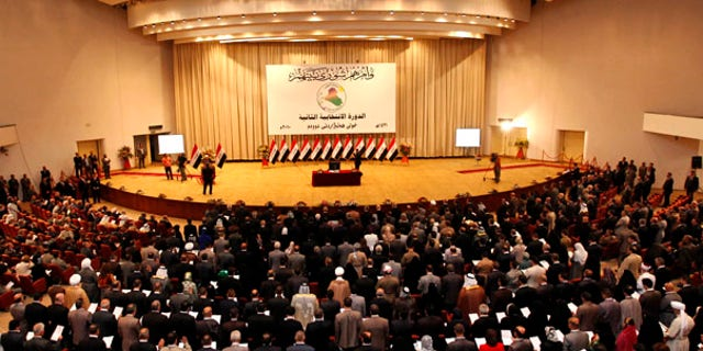 June 14: The members of the new Iraqi Parliament take the oath in the first session of Iraqi Parliament in Baghdad.