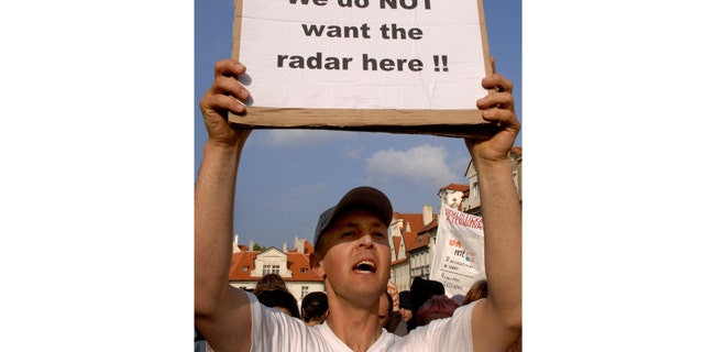 This June 4, 2007, file photo shows a Czech protester holding a banner against a possible radar base during a demonstration in Prague, Czech Republic.