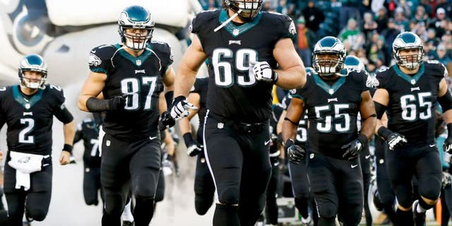 Dec 7, 2014; Philadelphia, PA, USA; Philadelphia Eagles guard Evan Mathis (69) and tight end Brent Celek (87) run out of the tunnel to begin a game against the Seattle Seahawks at Lincoln Financial Field. The Seahawks defeated the Eagles 24-14. Mandatory Credit: Bill Streicher-USA TODAY Sports