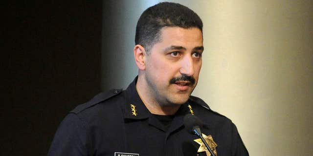 This July 16, 2013 photo shows Oakland Police Assistant Chief Paul Figueroa during a city council meeting in Oakland, Calif.