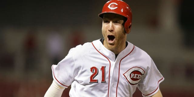 Todd Frazier, seen as a Cincinnati Red on June 18, 2015, reacts after hitting a grand slam in the 13th inning of a MLB game against the Detroit Tigers. (Associated Press)