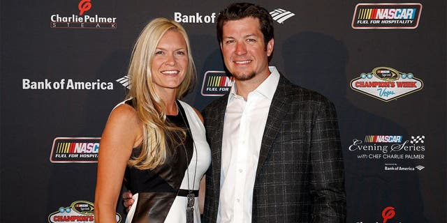 LAS VEGAS, NV - NOVEMBER 28: Driver Martin Truex Jr. (R) and Sherry Pollex (L) pose during the NASCAR Evening Series at Charlie Palmer Steak part of the Four Seasons Hotel Las Vegas on November 28, 2012 in Las Vegas, Nevada. (Photo by Chris Graythen/Getty Images for NASCAR)