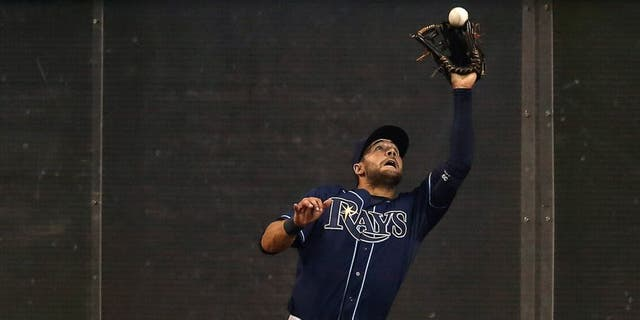 TORONTO, CANADA - APRIL 14: Kevin Kiermaier #39 of the Tampa Bay Rays makes a catch against the wall in the ninth inning during MLB game action against the Toronto Blue Jays on April 14, 2015 at Rogers Centre in Toronto, Ontario, Canada. (Photo by Tom Szczerbowski/Getty Images)