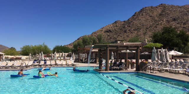 June 19, 2016: Hotel guests cool off at the pool at the JW Marriott Scottsdale Camelback Inn Resort and Spa in Paradise Valley, Ariz.