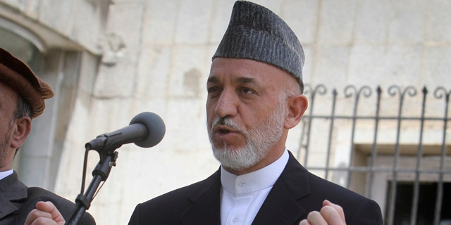 June 23: Afghan President Hamid Karzai speaks during a press event at the presidential palace in Kabul, Afghanistan. This week he spoke out condemning the killing of an 8-year-old boy by the Taliban.