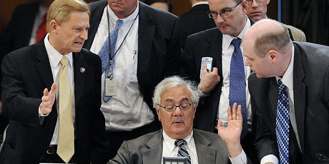 June 24: House Financial Services Committee Chairman Barney Frank talks with a group lawmakers, including Ranking Member Spencer Bachus, left, during a committee conference on Wall Street reform on Capitol Hill.