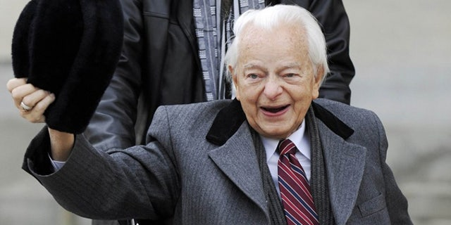 Feb. 2009: Sen. Robert Byrd doffs his hat for reporters as he arrives at the Capitol in Washington.