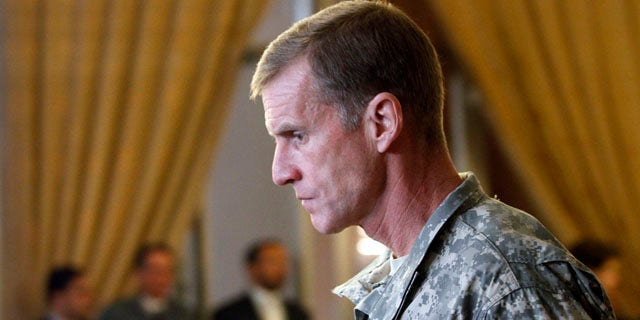 In this Jan. 20, 2010 file photo, Gen. Stanley McChrystal, then Commander of the International Security Assistance Forces (ISAF) and Commander of United States Forces in Afghanistan, arrives to attend at the 13th Joint Coordination and Monitoring Board (JCMB) Meeting in Kabul, Afghanistan.