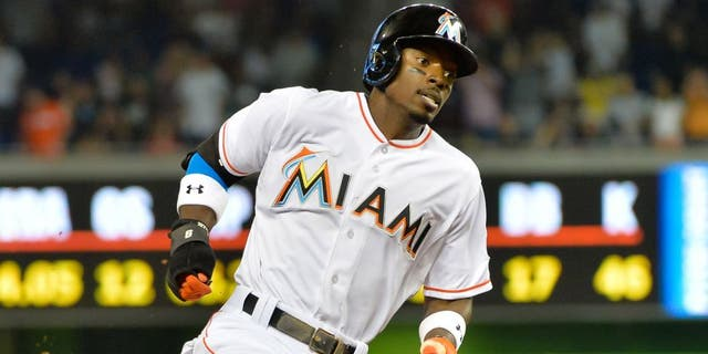 Jun 16, 2015; Miami, FL, USA; Miami Marlins second baseman Dee Gordon (9) runs the bases and scores a run during the first inning against the New York Yankees at Marlins Park. Mandatory Credit: Steve Mitchell-USA TODAY Sports