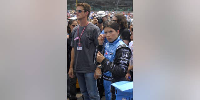 Hospenthal, left, is seen with now-ex-wife Danica Patrick at a race.