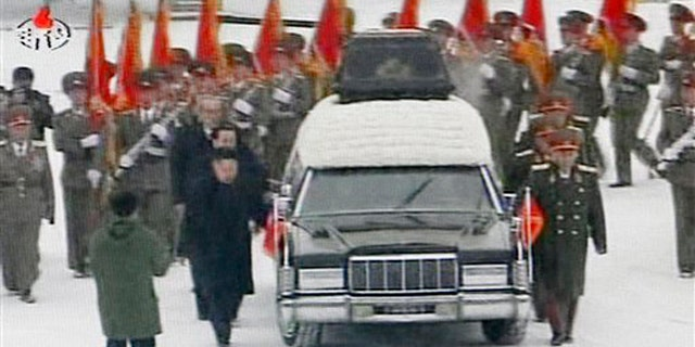 Dec. 28, 2011: In this image made from KRT television, a hearse is driven during a funeral procession of North Korean leader Kim Jong Il in the snow in Pyongyang.