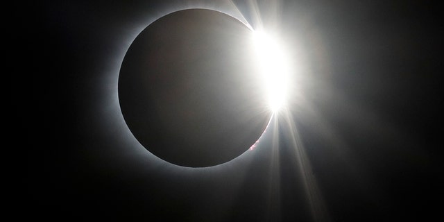 The solar eclipse totality ends Monday, Aug. 21, 2017, over the Orchard Dale historical farm near Hopkinsville, Ky. The location, which is in the path of totality, is also at the point of greatest intensity. (AP Photo/Mark Humphrey)