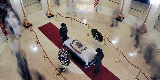 July 1: People file past Sen. Byrd's casket in the Charleston, W.Va. capitol building.