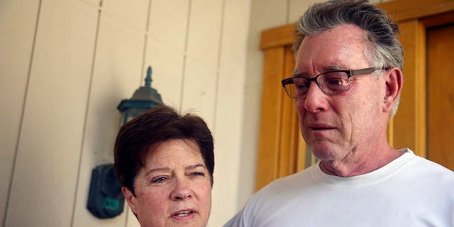 """July 2, 2015: Liz Sullivan, left, and Jim Steinle, right, parents of Kathryn """"Kate"""" Steinle, talk to members of the media outside their home in Pleasanton, Calif."""