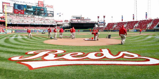 Mar 31, 2014; Cincinnati, OH, USA; A general view of the Cincinnati Reds grounds keepers preparing the field prior to the game against the St. Louis Cardinals at Great American Ball Park. Mandatory Credit: Frank Victores-USA TODAY Sports