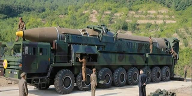 This image made from video of a news bulletin aired by North Korea's KRT on Tuesday, July 4, 2017, shows what was said to be the preparation of the launch of a Hwasong-14 intercontinental ballistic missile, ICBM, in North Korea's northwest.