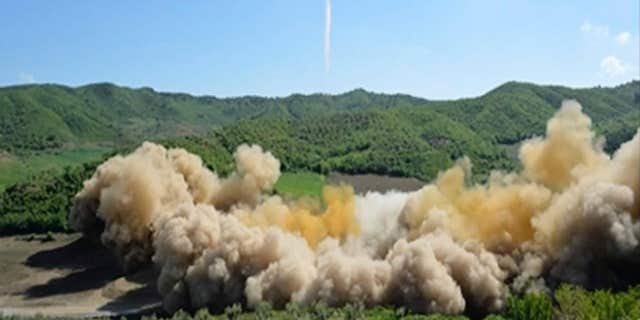 This image made from video of a news bulletin aired by North Korea's KRT on Tuesday, July 4, 2017, shows what was said to be the launch of a Hwasong-14 intercontinental ballistic missile, ICBM, in North Korea's northwest.