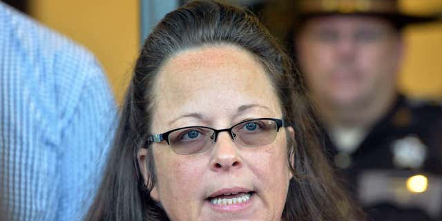 FILE - In this Sept. 14, 2015, file photo, Rowan County Clerk Kim Davis makes a statement to the media at the front door of the Rowan County Judicial Center in Morehead, Ky.