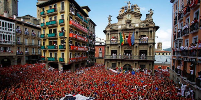 July 6: Revelers hold up traditional red neckties during the 'Chupinazo', the official opening of the 2010 San Fermin fiestas in Pamplona, Spain.