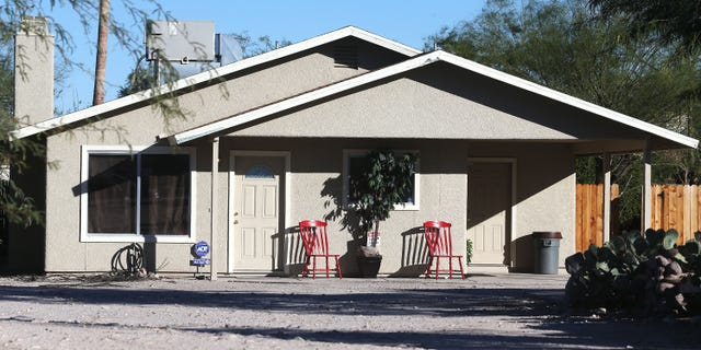 This Tuesday, Nov. 26, 2013 photo shows the home where three girls were allegedly imprisoned by their mother and stepfather, in Tucson, Ariz. Tucson Police Capt. Michael Gillooly said Tuesday at a news conference that all three girls were malnourished and dirty, and they told officers they hadn't taken a bath in up to six months. The couple made their initial court appearances Wednesday. (AP Photo/Arizona Daily Star, Mike Christy)  ALL LOCAL TV OUT; PAC-12 OUT; MANDATORY CREDIT