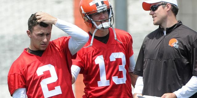 Jun 16, 2015; Berea, OH, USA; Cleveland Browns quarterback Johnny Manziel (2), Cleveland Browns quarterback Josh McCown (13), Cleveland Browns quarterbacks coack Kevin O'Connell and Cleveland Browns quarterback Connor Shaw (9) during minicamp at the Cleveland Browns practice facility. Mandatory Credit: Ken Blaze-USA TODAY Sports