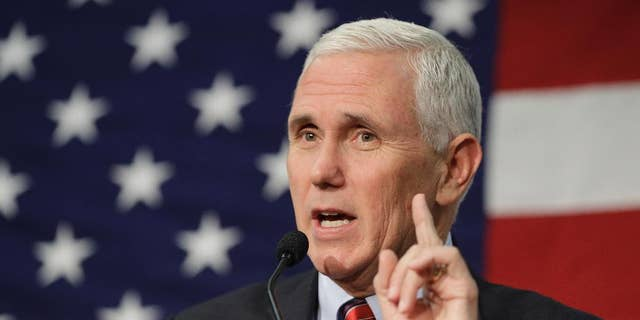 """FILE -In this Sept. 30, 2016 file photo, Republican vice presidential candidate, Indiana Gov. Mike Pence speaks in Fort Wayne, Ind. Pence musters all of his Midwestern earnestness as he describes Donald Trump as """"a man of faith."""" He says the Republican nominee is """"a man I've prayed with and gotten to know on a personal level."""" The description, in an interview with The Associated Press, stands in sharp relief to Trump's public profile over much of his career: a twice-divorced former playboy who has boasted of his sexual exploits, flaunted his wealth, used crass insults and made sweeping generalizations about whole races.  (AP Photo/Darron Cummings, File)"""