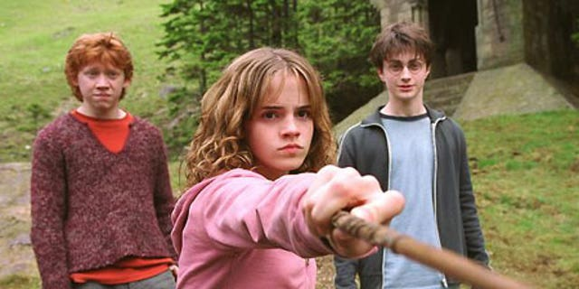 """May 1, 2004: Emma Watson with co-stars Rupert Grint and Daniel Radcliffe in a scene from the movie """"Harry Potter And The Prisoner Of Azkaban."""""""