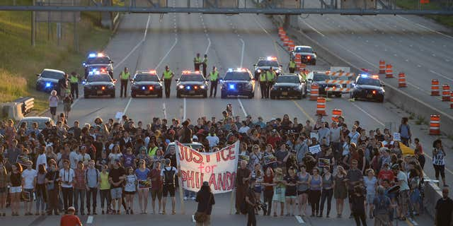 Marchers block part of Interstate 94 in St. Paul, Minn., Saturday, July 9, 2016, during a protest sparked by the recent police killings of black men in Minnesota and Louisiana.