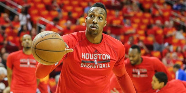 May 17, 2015; Houston, TX, USA; Houston Rockets center Dwight Howard (12) warms up before game seven of the second round of the NBA Playoffs against the Los Angeles Clippers at Toyota Center. Mandatory Credit: Troy Taormina-USA TODAY Sports