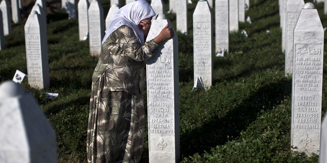 July 11, 2015: A woman weeps as she visits the grave of a family member at the Potocari memorial complex near Srebrenica, 94 miles northeast of Sarajevo, Bosnia and Herzegovina.