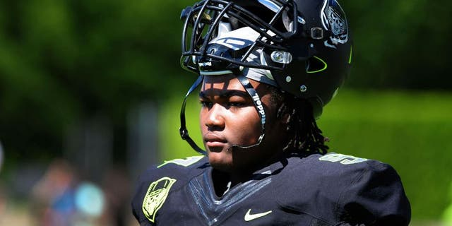 Jul 10, 2014; Beaverton, OR, USA; Defensive lineman Rashan Gary (97) looks on from the sidelines during Nike Football ' The Opening' at Nike World Headquarters. Mandatory Credit: Steve Dykes-USA TODAY Sports