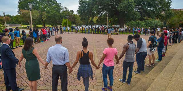 July 11, 2016: People pray during Prayer Vigil organized by Myron Smothers at Memorial Tower on the Louisiana State University campus in Baton Rouge, La.