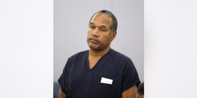 In this Dec. 5, 2008 file photo, O.J. Simpson stands in court during his sentencing hearing at the Clark County Regional Justice Center in Las Vegas.