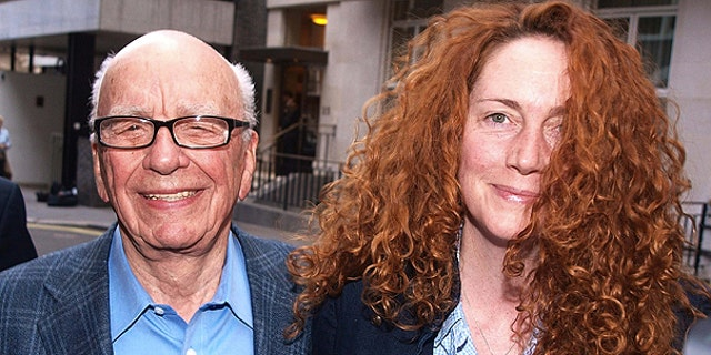July 10: This photo shows Chairman of News Corporation Rupert Murdoch, left, and Chief executive of News International Rebekah Brooks as they leave his residence in central London.