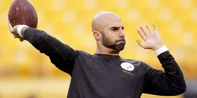 Nov 17, 2013; Pittsburgh, PA, USA; Pittsburgh Steelers quarterback Bruce Gradkowski (5) warms-up on the field before playing the Detroit Lions at Heinz Field. Mandatory Credit: Charles LeClaire-USA TODAY Sports