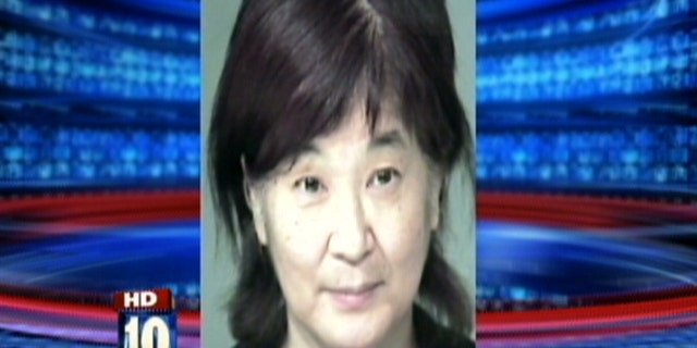 Mugshot of 61-year-old Yukari Mihamae.