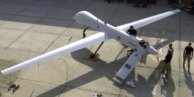 FILE: Members of the 11th Reconnaissance Squadron from Indian Springs, Nev., perform pre-flight checks on a Predator unmanned aerial vehicle prior to a mission.