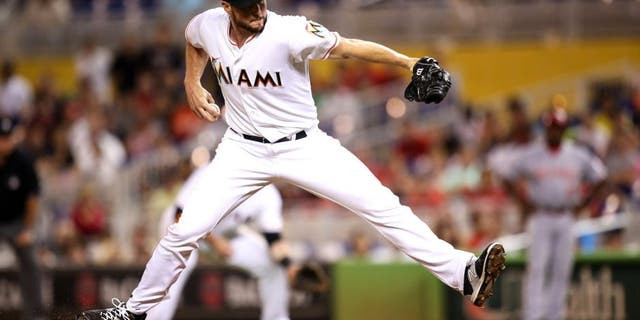 MIAMI, FL - JULY 09: Carter Capps #22 of the Miami Marlins in action during the game against the Cincinnati Reds at Marlins Park on July 9, 2015 in Miami, Florida. (Photo by Rob Foldy/Getty Images)