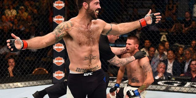 LAS VEGAS, NV - JULY 11: Matt Brown reacts to his victory over Tim Means in their welterweight fight during the UFC 189 event inside MGM Grand Garden Arena on July 11, 2015 in Las Vegas, Nevada. (Photo by Josh Hedges/Zuffa LLC/Zuffa LLC via Getty Images)
