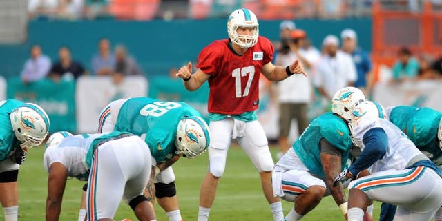Jul 29, 2013; Miami, FL, USA; Miami Dolphins quarterback Ryan Tannehill (17) calls out plays at the line of scrimmage during a scrimmage at Sun Life Stadium. Mandatory Credit: Steve Mitchell-USA TODAY Sports