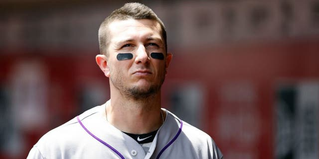 CINCINNATI, OH - MAY 27: Troy Tulowitzki #2 of the Colorado Rockies looks on against the Cincinnati Reds during the game at Great American Ball Park on May 27, 2015 in Cincinnati, Ohio. The Rockies defeated the Reds 6-4. (Photo by Joe Robbins/Getty Images)