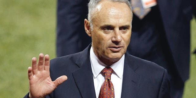 CINCINNATI, OH - JULY 14: Commissioner of Major League Baseball Rob Manfred waves during the 86th MLB All-Star Game at the Great American Ball Park on July 14, 2015 in Cincinnati, Ohio. (Photo by Joe Robbins/Getty Images)