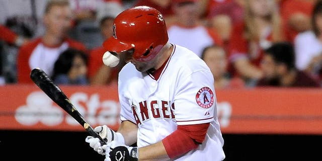 ANAHEIM, CA - JULY 22: David Freese #6 of the Los Angeles Angels of Anaheim is hit in the hand by a ball in the fourth inning during a game against the Minnesota Twins at Angel Stadium of Anaheim on July 22, 2015 in Anaheim, California. (Photo by Jonathan Moore/Getty Images)