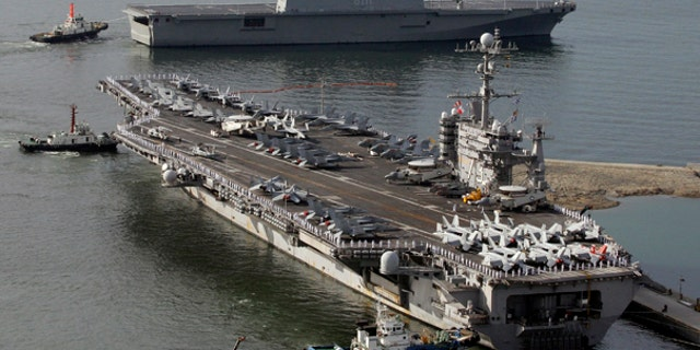 July 25: The USS George Washington, a nuclear-powered U.S. supercarrier, leaves for joint military exercises at the Busan port in Soth Korea.